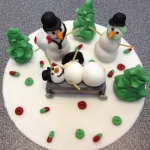 sledging snowman cake
